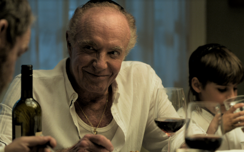 "In ""Holy Lands,"" James Caan plays a secular American Jew who moves to Israel to escape the drama of his family — and to raise pigs. (Cinedigm/via JTA)"