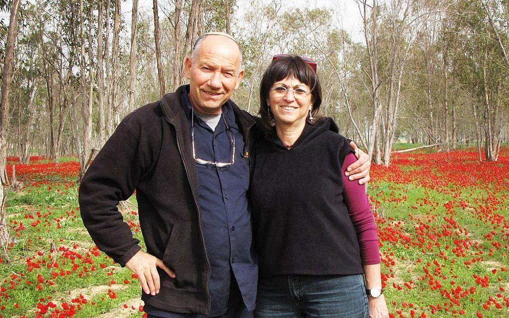 Yoskeh and Nurit Marmurstein enjoy winter blossoms in Alumim, Israel, in 2012. (Courtesy of Yoskeh Marmurstein/via JTA)