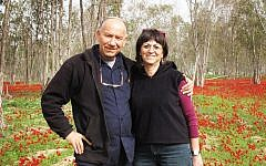 Yoskeh and Nurit Marmurstein enjoy winter blossoms in Alumim, Israel, in 2012. (Courtesy of Yoskeh Marmurstein/via JTA)