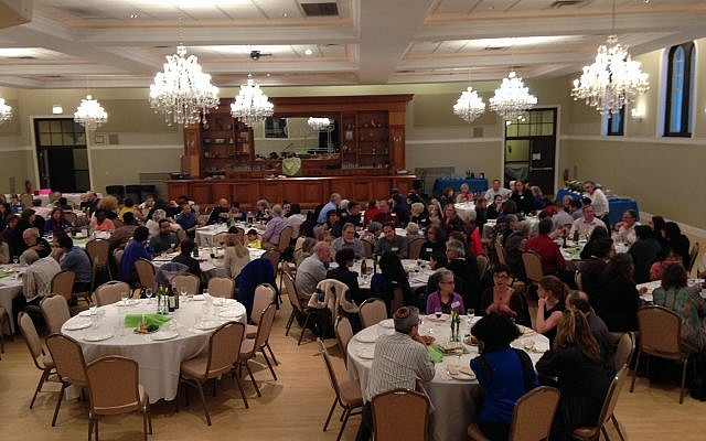 Members of Tzedek Chicago hold a Passover seder in 2018 in Chicago. (Courtesy of Tzedek Chicago/via JTA)