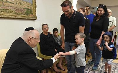 President Reuven Rivlin (L) greets people paying their respects to his wife during the traditional Shiva mourning period. (Mark Neyman/GPO)