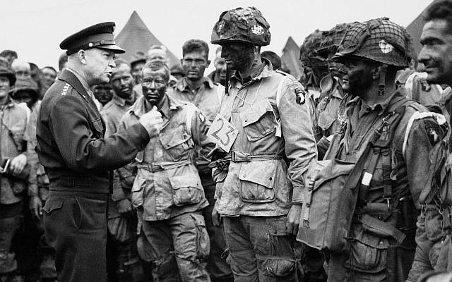 In this June 6, 1944, file photo, US Gen. Dwight D. Eisenhower, left, gives the order of the day to paratroopers in England prior to boarding their planes to participate in the first assault of the Normandy invasion. (US Army Signal Corps via AP)
