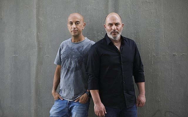 "In this May 30, 2019 photo, co-creators of Israel's hit TV show ""Fauda"" Avi Issacharoff, left, who is also the Times of Israel's Arab affairs analyst, and Lior Raz pose for a photo in Tel Aviv, Israel. (AP Photo/Oded Balilty)"