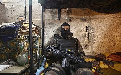 "In this May 30, 2019 photo, an actor waits for his scene on the set of Israel's hit TV show ""Fauda,"" in Tel Aviv, Israel. (AP Photo/Oded Balilty)"