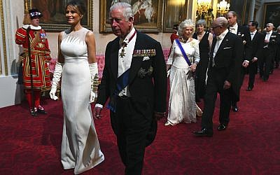 First lady Melania Trump, second left and Britain's Prince Charles arrive through the East Gallery ahead of the State Banquet at Buckingham Palace in London, June 3, 2019. (Victoria Jones/Pool Photo via AP)