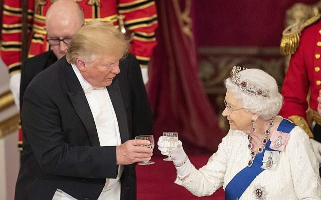 US President Donald Trump, left and Queen Elizabeth II toast, during the State Banquet at Buckingham Palace, in London, June 3, 2019. (Dominic Lipinski/Pool Photo via AP)
