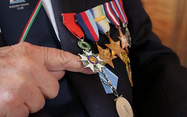 D-Day veteran Donald Hitchcock poses for a photo wearing his campaign medals aboard the MV Boudicca ship as veterans return to the scene of the D-Day landings 75 years after the Allied invasion of northern France, Tuesday June 4, 2019. Hitchcock is desperate to spend D-Day commemoration on Omaha Beach with the Americans he served alongside all those years ago. Many veterans are returning to the scene where as young men they stormed the beaches of Normandy in northern France during World War II, with the fate of the free world resting on their shoulders. (AP Photo/Ben Jary)