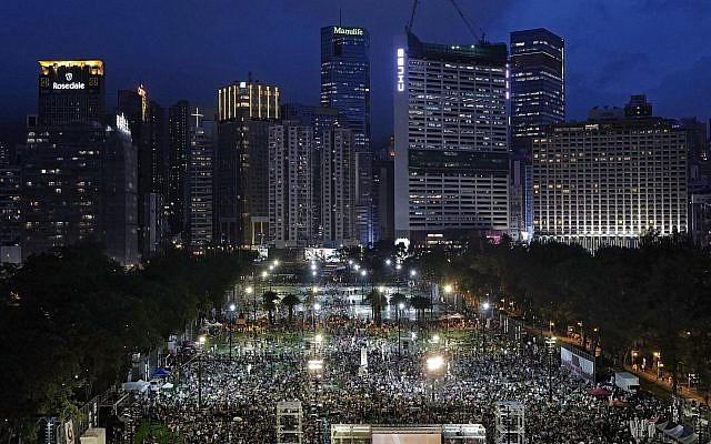 Thousands of people attend a candlelight vigil for victims of the Chinese government's brutal military crackdown three decades ago on protesters in Beijing's Tiananmen Square at Victoria Park in Hong Kong, June 4, 2019. (AP Photo/Vincent Yu)