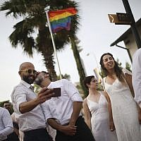 Gay couples prepare for a same-sex wedding in Tel Aviv, Israel, June 4, 2019. (AP/Oded Balilty)