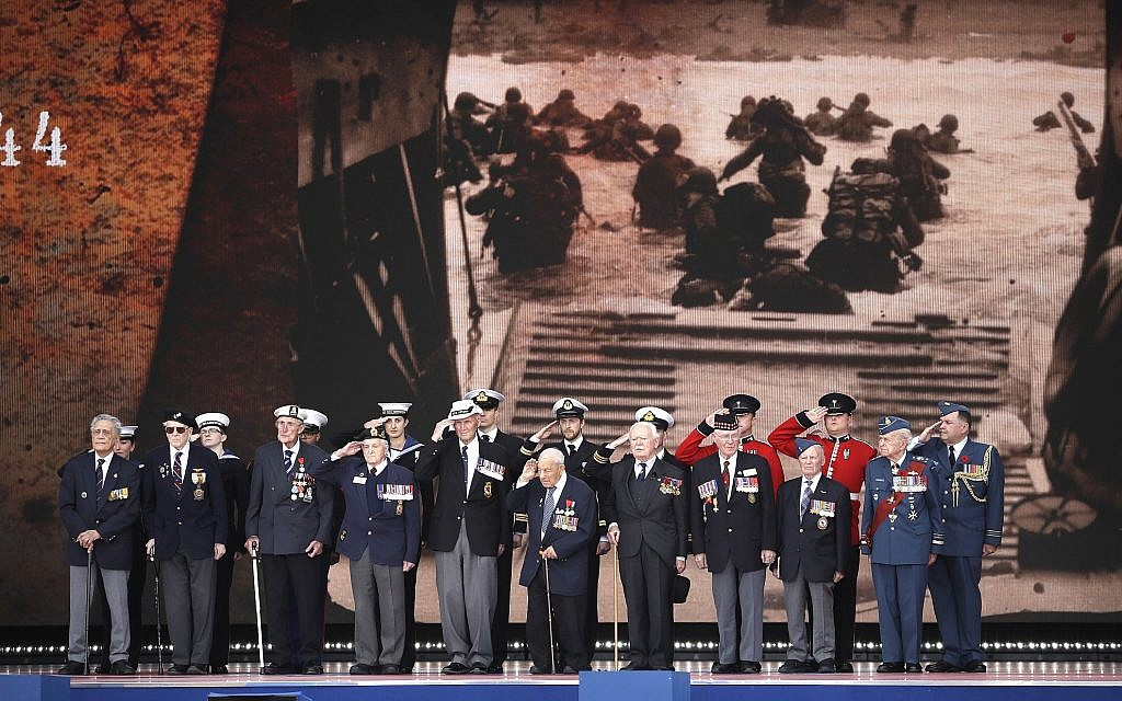D-Day veterans, front row, stand on stage during an event to mark the 75th anniversary of D-Day in Portsmouth, England, June 5, 2019. World leaders including US President Donald Trump gathered on the south coast of England to mark the 75th anniversary of the D-Day landings. (AP Photo/Matt Dunham)