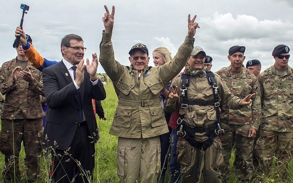 US World War II D-Day veteran Tom Rice, from Coronado, California, after parachuting in a tandem jump into a field in Carentan, Normandy, France, on June 5, 2019. Approximately 200 parachutists participated in the jump over Normandy, replicating a jump made by US soldiers on June 6, 1944 as a prelude to the seaborne invasions on D-Day. (AP Photo/Rafael Yaghobzadeh)