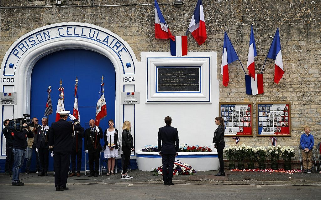 French president Emmanuel Macron attends a ceremony at the Caen prison to pay tribute to French resistants as part of D-Day ceremonies in Caen, June 5, 2019. On June 5, 1944, the Germans shot over 80 people at the prison of Caen, including 71 who have been identified as members of the French Resistance. (AP Photo/Francois Mori, pool)
