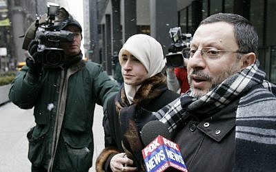 In this photo from February 1, 2007, Abdelhaleem Ashqar is surrounded by cameramen as he leaves federal court with his wife, in Chicago. (AP Photo/Charles Rex Arbogast)