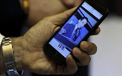 Ziad Zakka, brother of Nizar Zakka who is imprisoned in Iran, shows a photo of his brother on his cellular telephone in Beirut, Lebanon,  July 18, 2017. (AP/Bilal Hussein)