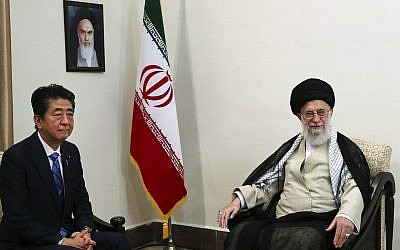 In this picture released by an official website of the office of the Iranian supreme leader, Ayatollah Ali Khamenei, right, meets with Japanese Prime Minister Shinzo Abe, in Tehran, Iran, June 13, 2019. (Office of the Iranian Supreme Leader via AP)