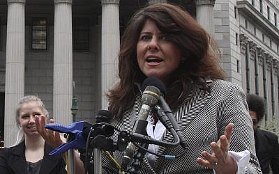 In this photo fro  March 29, 2012, author and political consultant Naomi Wolf speaks to reporters during a news conference in New York. (AP Photo/Mary Altaffer)