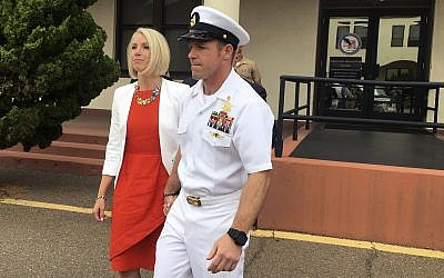 Navy Special Operations Chief Edward Gallagher leaves a military courtroom on Naval Base San Diego with his wife, Andrea Gallagher, in San Diego, May 30, 2019. (Julie Watson/AP)