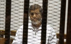 Egypt's ousted Islamist President Mohammed Morsi sits in a defendant cage in the Police Academy courthouse in Cairo, Egypt, May 8, 2014. (Tarek el-Gabbas/AP)