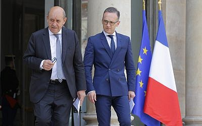French Foreign Minister Jean-Yves Le Drian, left, and his German counterpart Heiko Maas arrive for a media conference after the cabinet meeting at the Elysee Palace in Paris, France, June 19, 2019. (AP Photo/Michel Euler)