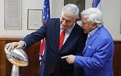 Prime Minister Benjamin Netanyahu holds the NFL Super Bowl trophy during a meeting with New England Patriots owner Robert Kraft in Jerusalem, June 20, 2019. (AP Photo/Sebastian Scheiner)