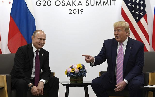 US President Donald Trump, right, meets with Russian President Vladimir Putin during a bilateral meeting on the sidelines of the G-20 summit in Osaka, Japan, June 28, 2019. (AP Photo/Susan Walsh)