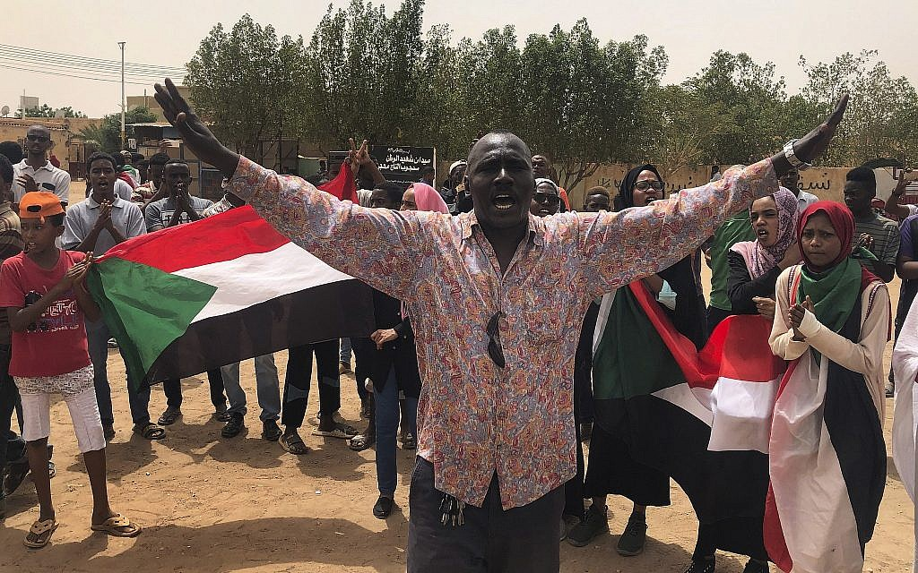 A Sudanese protester shouts slogans during a demonstration against the military council, in Khartoum, Sudan, on June 30, 2019. (AP Photo/Hussein Malla)