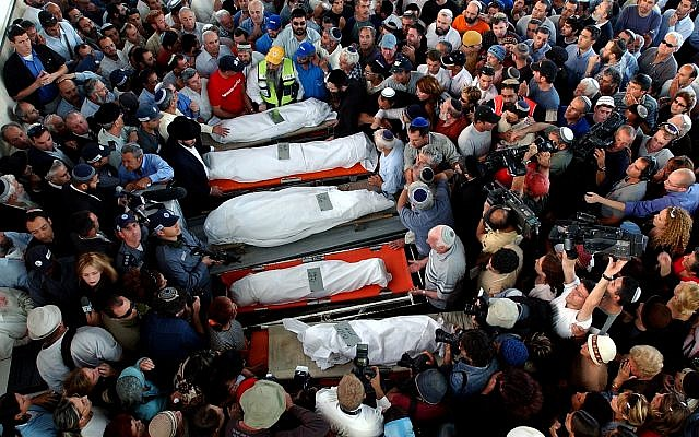 Mourners attend the funerals of Tali Hatuel, 34, who was eight months pregnant and her four daughters, aged two to 11, at the Ashkelon cemetery on Sunday, May 2, 2004. (AP Photo/Ariel Schalit)