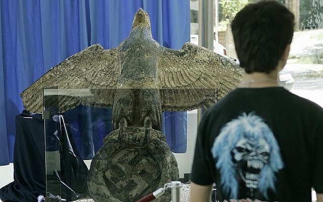 A Uruguayan resident observes the eagle on display from the German battleship Graf Spee in Montevideo, Uruguay, Feb. 14, 2006 (AP Photo/Marcelo Hernandez) (AP Photo/Marcelo Hernandez).