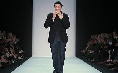 Fashion designer Isaac Mizrahi reacts to applause after presenting his Spring 2011 collection, Thursday, September 16, 2010, during Fashion Week in New York. (AP Photo/Bebeto Matthews)