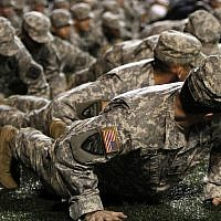 Illustrative -- Members of the UAB and Samford ROTC programs perform pushups on the sideline for every touchdown scored in honor of Veterans Day during an NCAA college football game between UAB and East Carolina on Nov. 11, 2010, in Birmingham, Alabama (AP Photo/Butch Dill)