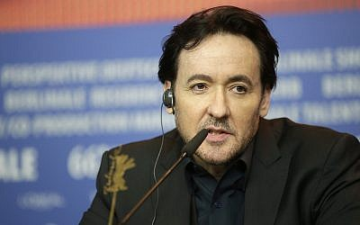 "Actor John Cusack responds, during a press conference for the film 'Chi-Raq"", at the 2016 Berlinale Film Festival in Berlin, Tuesday, Feb. 16, 2016. (AP Photo/Michael Sohn)"