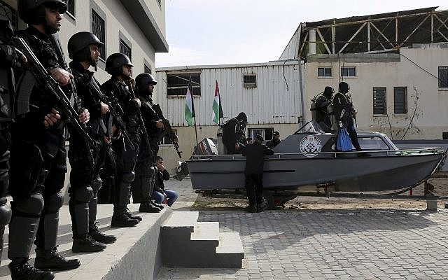 Palestinian Hamas naval forces stand at attention during the opening ceremony of the terror group's first navy headquarters in Gaza City, on December 22, 2016. (AP/Adel Hana)