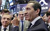 Altice founder Patrick Drahi, right, waits with company executives for the Altice IPO to begin trading, on the floor of the New York Stock Exchange, Thursday, June 22, 2017. (AP Photo/Richard Drew)