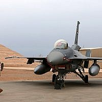 In this illustrative photo from February 13, 2018, an Iraqi army soldier stands guard near a US- made Iraqi Air Force F-16 fighter jet at the Balad Air Base, 45 miles north of Baghdad, Iraq. (AP Photo/Khalid Mohammed)