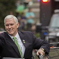 Vice President Mike Pence gives the crowd a thumbs-up before climbing into his motorcade at the Savannah St. Patrick's Day parade, March 17, 2018, in Savannah, Georgia. (AP Photo/Stephen B. Morton)