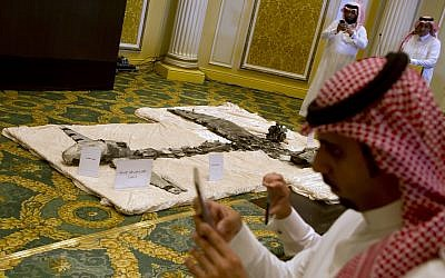Illustrative: Reporters film the scene during a media presentation of what Saudi officials say is the wreckage of Iranian-Houthi suicide drones, in Khobar city, Saudi Arabia, April 16, 2018. (AP Photo/Amr Nabil)
