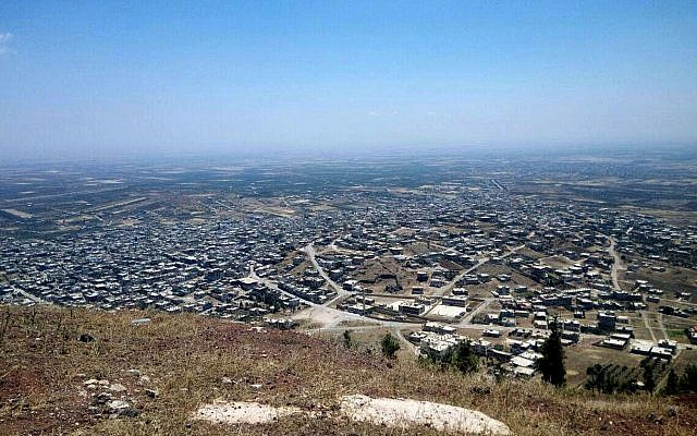 This photo released Tuesday, July 17, 2018, by the Syrian official news agency SANA, shows a general view of Tel al-Haara, from the highest hill in the southwestern Daraa province, Syria. (SANA/AP)
