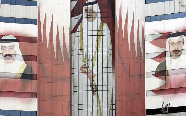 This Oct. 3, 2011, file photo shows an office tower in Manama, Bahrain, which bears images of Bahraini King Hamad bin Isa Al Khalifa, center, Prime Minister Khalifa bin Salman Al Khalifa, left, and Crown Prince Salman bin Hamad Al Khalifa, right (AP Photo/Hasan Jamali, File)
