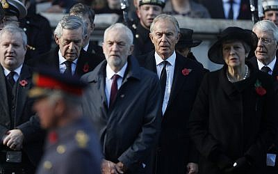 Britain's Prime Minister Theresa May, right, Former Prime Minister Tony Blair, center right,  Labour Party leader Jeremy Corbyn, center, and former prime minister Gordon Brown, rear left, attend the Remembrance Sunday ceremony at the Cenotaph in London, Sunday, Nov. 11, 2018. . (AP Photo/Alastair Grant)