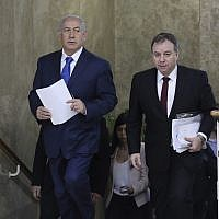 Prime Minister Benjamin Netanyahu, left, and Prime Minister's Office Director-General Yoav Horowitz, right, arrive for the weekly cabinet meeting at the Prime Minister's Office in Jerusalem, December 16, 2018. (Abir Sultan/Pool Photo via AP)