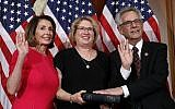 House Speaker Nancy Pelosi of Calif., left, poses during a ceremonial swearing-in with Rep. Alan Lowenthal, D-Calif., right, on Capitol Hill, Thursday, Jan. 3, 2019 in Washington during the opening session of the 116th Congress.. (AP Photo/Alex Brandon)