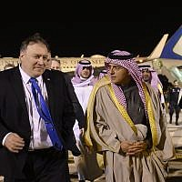 US Secretary of State Mike Pompeo, left, is greeted by Saudi's Minister of State for Foreign Affairs Adel al-Jubeir, center, in Riyadh on Sunday, January 13, 2019, during his Middle East tour. (Andrew Caballero-Reynolds/Pool Photo via AP)