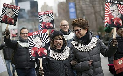 Supporters of Justice Ruth Bader Ginsburg march in during the Women's March Alliance, Saturday, Jan. 19, 2019, in New York. (AP Photo/Mary Altaffer)