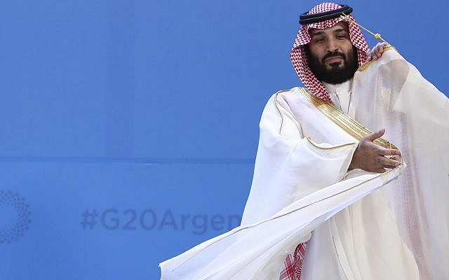In this November 30, 2018 file photograph, Saudi Arabia's Crown Prince Mohammed bin Salman adjusts his robe as leaders gather for the group at the G20 Leader's Summit at the Costa Salguero Center in Buenos Aires, Argentina. (AP Photo/Ricardo Mazalan, File)