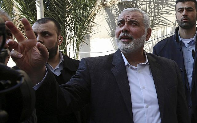 Hamas leader Ismail Haniyeh tours the site of a destroyed building in Gaza City, March 27, 2019. (AP Photo/Adel Hana)