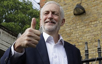 Jeremy Corbyn leader of Britain's opposition Labour Party gives the thumbs up after voting in the European Elections in London, Thursday, May 23, 2019. (AP Photo/Kirsty Wigglesworth)