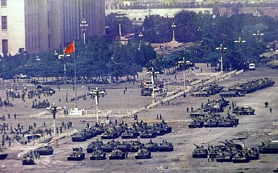 FILE - In this June 5, 1989 photo, Chinese troops and tanks gather in Beijing, one day after the military crackdown that ended a seven week pro-democracy demonstration on Tiananmen Square.  (AP Photo/Jeff Widener, File)
