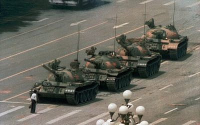 In this June 5, 1989 file photo, a Chinese man stands alone to block a line of tanks heading east on Beijing's Changan Blvd. in Tiananmen Square (AP Photo/Jeff Widener, File )