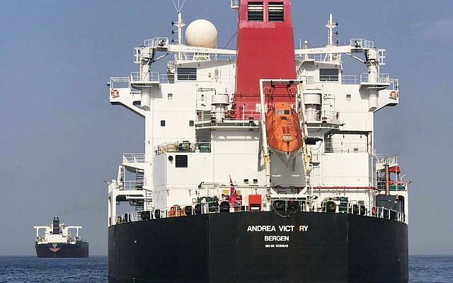 FILE - This May 13, 2019, photo provided by the United Arab Emirates' National Media Council shows the Norwegian-flagged oil tanker MT Andrea Victory off the coast of Fujairah, United Arab Emirates (United Arab Emirates National Media Council via AP, File)