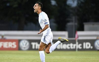 Illustrative: Eran Zahavi celebrates after he scored goal during their Euro 2020 group G qualifying soccer match between Latvia and Israel in Riga, Latvia, June 7, 2019. (AP Photo/Roman Koksarov)
